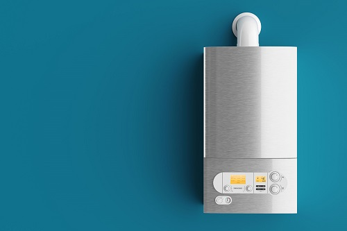 A Tankless Water Heater on a Blue Wall
